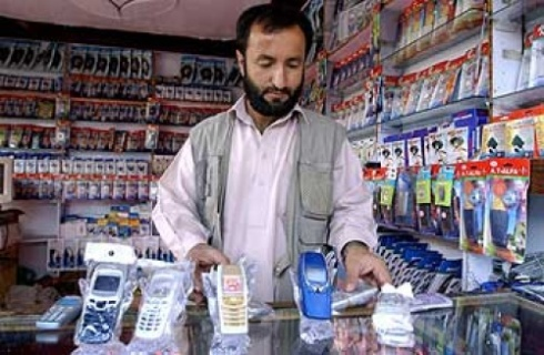 Afghani Cell Dealer, Image from The Cutting Edge News
