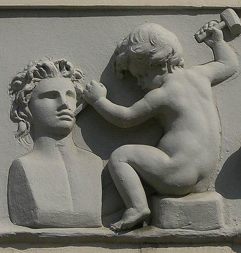 Chiseling Baby Sculpture